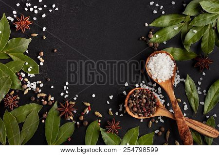 Spices And Salt On Black Background With Copyspace. Flatlay. Template For Menu