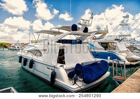 Luxury Yachts Docked In The Port In Bay At Sunny Day With Clouds On Blue Sky In La Romana, Dominican