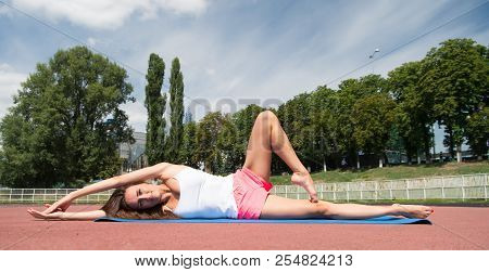Yoga Helps Find Harmony. Woman Flexible Body Practice Yoga Lay Fitness Mat Outdoors Nature Backgroun