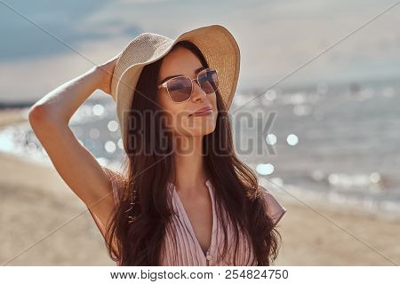 Portrait Of A Smiling Beautiful Brunette Girl With Long Hair In Sunglasses And Sunglasses Wearing A