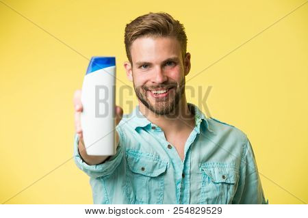 Guy Satisfied With This Shampoo. Man Bearded Stylish Holds Plastic Bottle. Guy Handsome Care About A