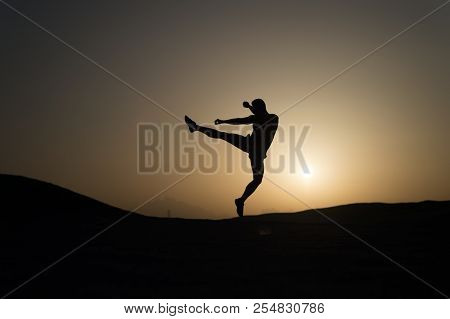 Hit Your Goal. Silhouette Man Motion Jump In Front Of Sunset Sky Background. Daily Motivation. Healt