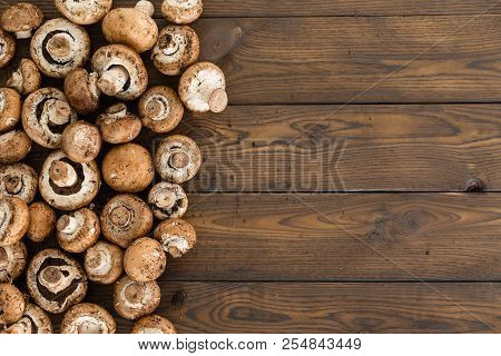 Side Border Of Fresh Raw Baby Bella Or Agaricus Bisporus Mushrooms On A Rustic Wood Background With
