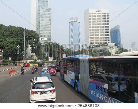 Jakarta, Indonesia - August 2, 2018: Traffic On Jalan Thamrin Around Bundaran Hotel Indonesia (hotel