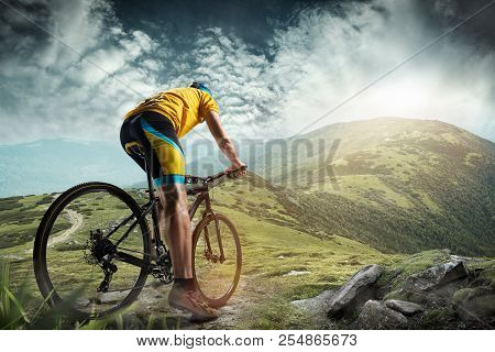 The Young Fit Man In Helmet Conquering Mountains On A Bicycle. The Bike, Nature, Bicycle, Sport, Cyc