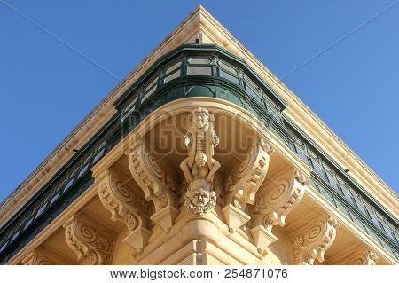 Symmetric Central Corner View Of Facade Wity Big Traditional Balcony Of Grandmaster Palace In Vallet