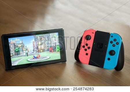 Joy-con Controllers And Console Nintendo Switch On Table Indoor, Gamepad And Video Game Console For