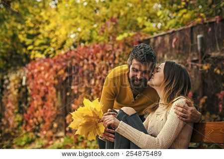 Love Relationship And Romance. Couple In Love In Autumn Park At Bench. Autumn Happy Couple Of Girl A