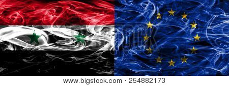 Syria Vs European Union Smoke Flags Placed Side By Side. Thick Colored Silky Smoke Flags Of Syrian A