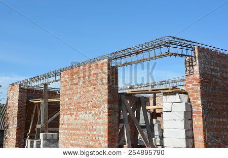 Reinforcement corner concrete bars with wire rod. Brickwork with iron bars intels for unfinished house construction. poster