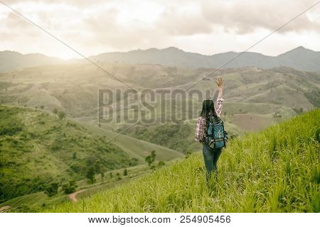 Asian Young Woman Enjoy And Stretching Her Arms With Sky Background In Nature Rice Farm, Her Is Feel
