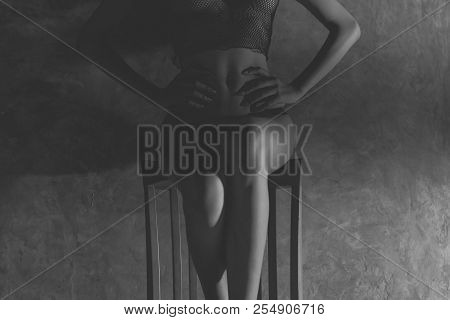 Woman With A Of Beautiful Body Naked Covered With White Cloth On The Bed. Black And White Tone.