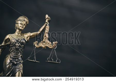 Law And Justice, Legality Concept, Scales Of Justice, Justitia, Lady Justice On A Black Wooden Backg