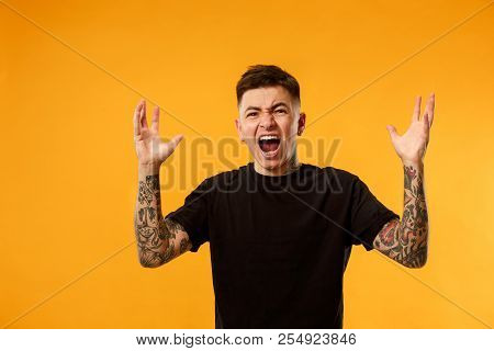 Screaming, Hate, Rage. Crying Emotional Angry Man Screaming On Studio Background. Emotional, Young F