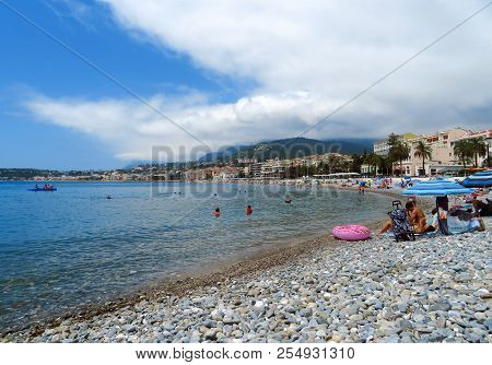Menton, France - June 30, 2018: Menton Beach And A Panoramic View Of The City. Unidentified People R