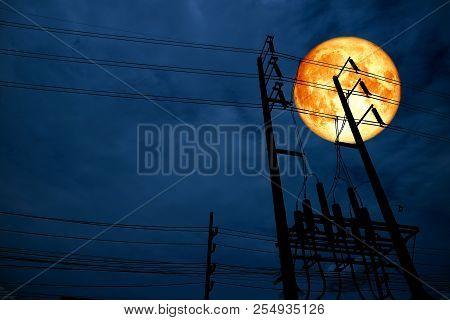 Blood Moon Back Silhouette Power Electric Pillar In Dark Night Sky