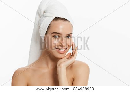 Spa Skin Care Beauty Woman Wearing Hair Towel After Beauty Treatment. Beautiful Young Woman With Per