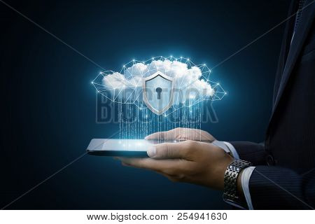 Concept Data Protection In Tablet . Data Cloud With A Protective Shield Shows The Businessman.