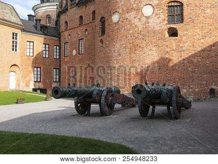Gripsholm Castle, Sweden On May 11. View Of The Courtyard. Older Cannon Of Russian Descent On May 11