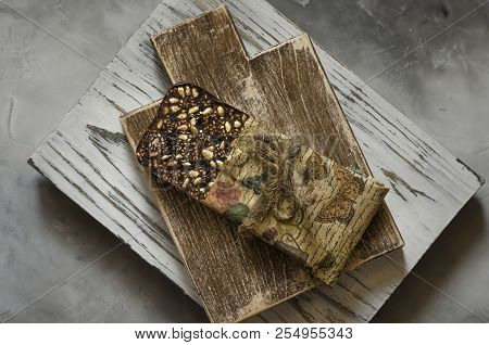 Chocolate With Sesame Seeds Of Pine Nuts And Goji Berries