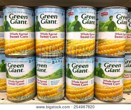 Alameda, Ca - February 15, 2018: Grocery Store Shelf Cans Of Green Giant Brand Corn.  Green Giant An