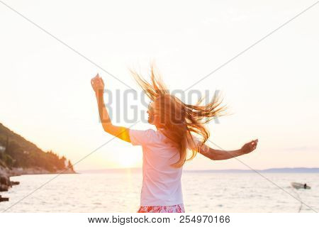 Lovely Woman With Hair Stripped By Wind