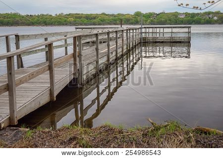 Beautiful Fishing Dock And Calm Waters On Starring Lake In Minnesota