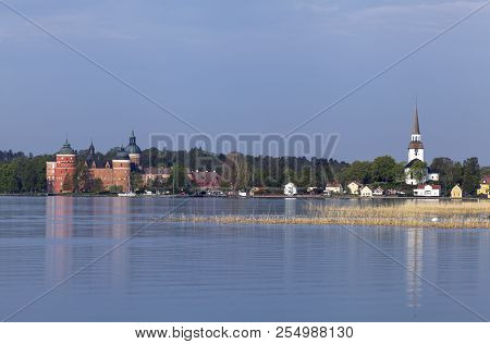 View Of Mariefred Town, Church And Gripsholm Castle From A Distance. Outlook From The Camping Right