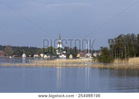 View Of Mariefred Town From A Distance. Outlook From The Camping Right Over The Lake. Church, Reed A