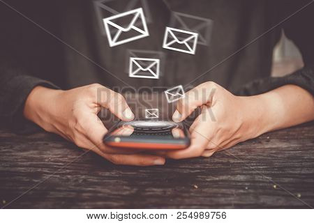 Woman Hand Using Smartphone To Send And Recieve Email For Business.