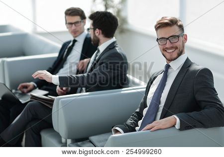 close up.successful business man sitting in a modern office