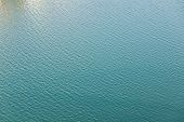 surface of quiet green waters of a port poster