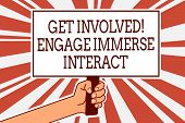Writing note showing Get Involved Engage Immerse Interact. Business photo showcasing Join Connect Participate in the project Man hand holding poster important protest green orange rays background. poster