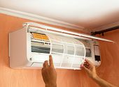 Cleaning Air Conditioning System At Home. Checking filter in the air-conditioner. The Concept of Safe and Healthy Housing poster