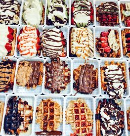Belgian Waffles. A Tempting Selection Of Fresh Belgian Waffles Topped With Chocolate, Speculoos And