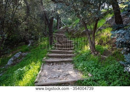 Wooden Stairs At Filopappou Hill, In Greece Drive Visitors To The Top Of It. Adventure, Hiking And H