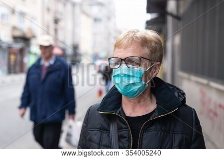 Beautiful With Mask On Street. Senior With Mask On Street. Woman Protecting From Virus. Virus. Virus