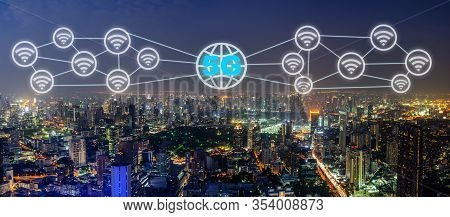 Communication Network Concept 5g And Internet Of Things With Smart City On Night Background. Modern