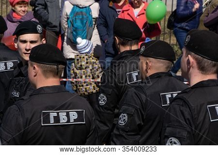 Russia Berezniki - 01.05.2018 : Group Of Rapid Response Team Police Officers In Riot Gear And Medic