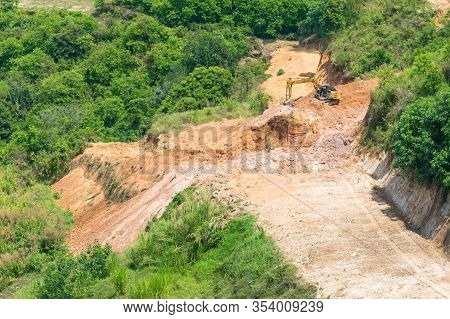 Working Excavator On A Mountainside In The Tropics