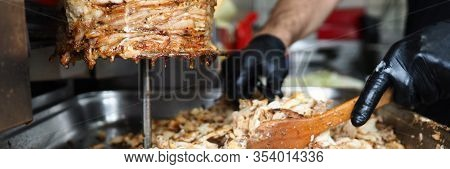 Close-up Meat On Special Equipment, Cook Shawarma. Modern Equipment For Street Trading. Opening Succ