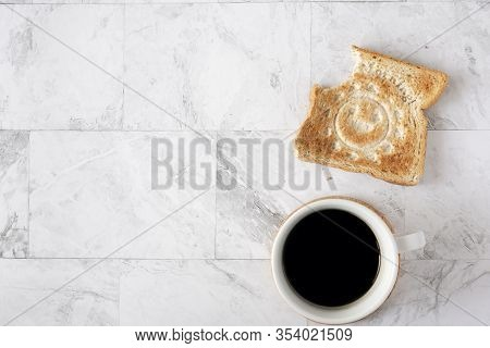 Topview Flat Lay Of Working Table With Coffee And Toast Bread.