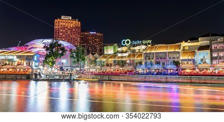 Singapore, Singapore - Aug 1, 2019 : Colorful Light Building At Night Historical Riverside Quay In C