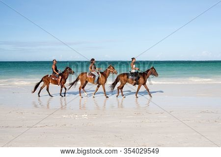 Zansibar, Tanzania - September 26, 2012: People On Holday Ride Horses On The Sanzibar Beach. Sanziba
