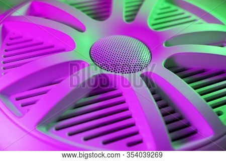 Colorful Lights Of Car Stereo And Car Speakers Background.  Car Music Audio Speaker In Green And Pin