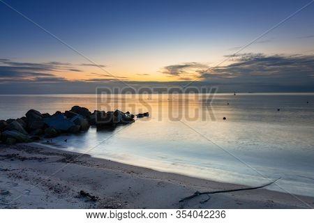 Beautiful sunrise over calm Baltic Sea in Poland