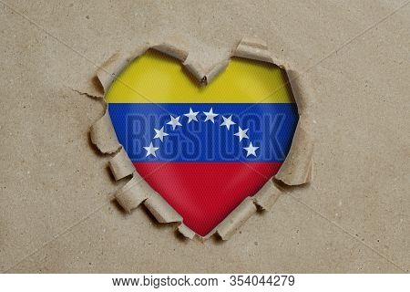 3d Illustration. Heart Shaped Hole Torn Through Paper, Showing Venezuelan Flag