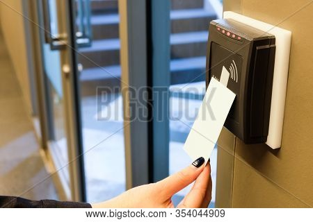 Women Hand Reaching To Use Rfid Key Card To Access To Office Building Area And Workspace. In Buildin