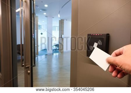 Men Hand Reaching To Use Rfid Key Card To Access To Office Building Area And Workspace. In Building