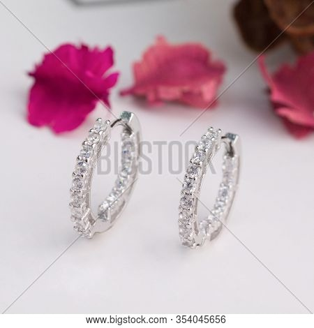 A Pair Of Beautiful Diamond Earrings Isolated On White Background